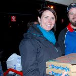 Receiving donated pizza from Domino's